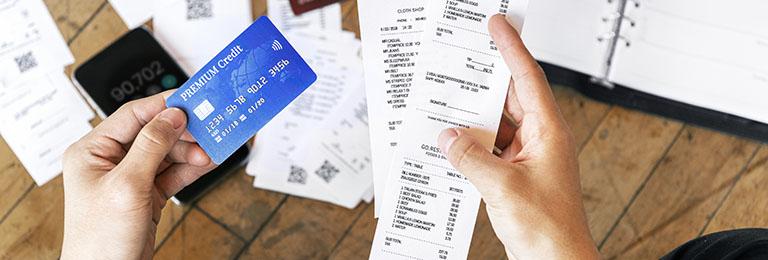 Man paying bills online via internet banking