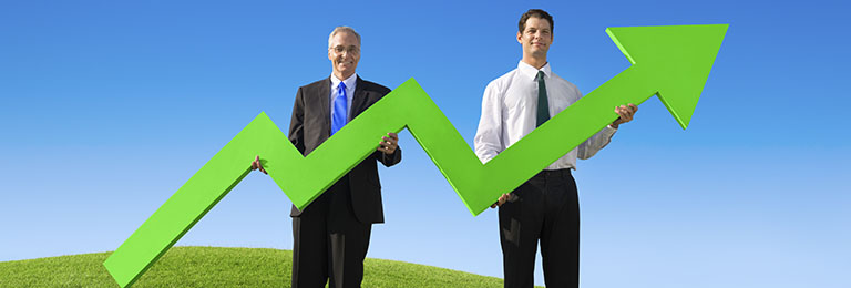 Two Businessmen holding the increase graph on the hill