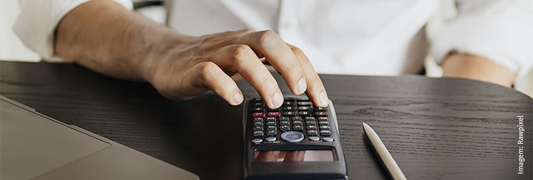 Man calculating his savings during the COVID-19 pandemic